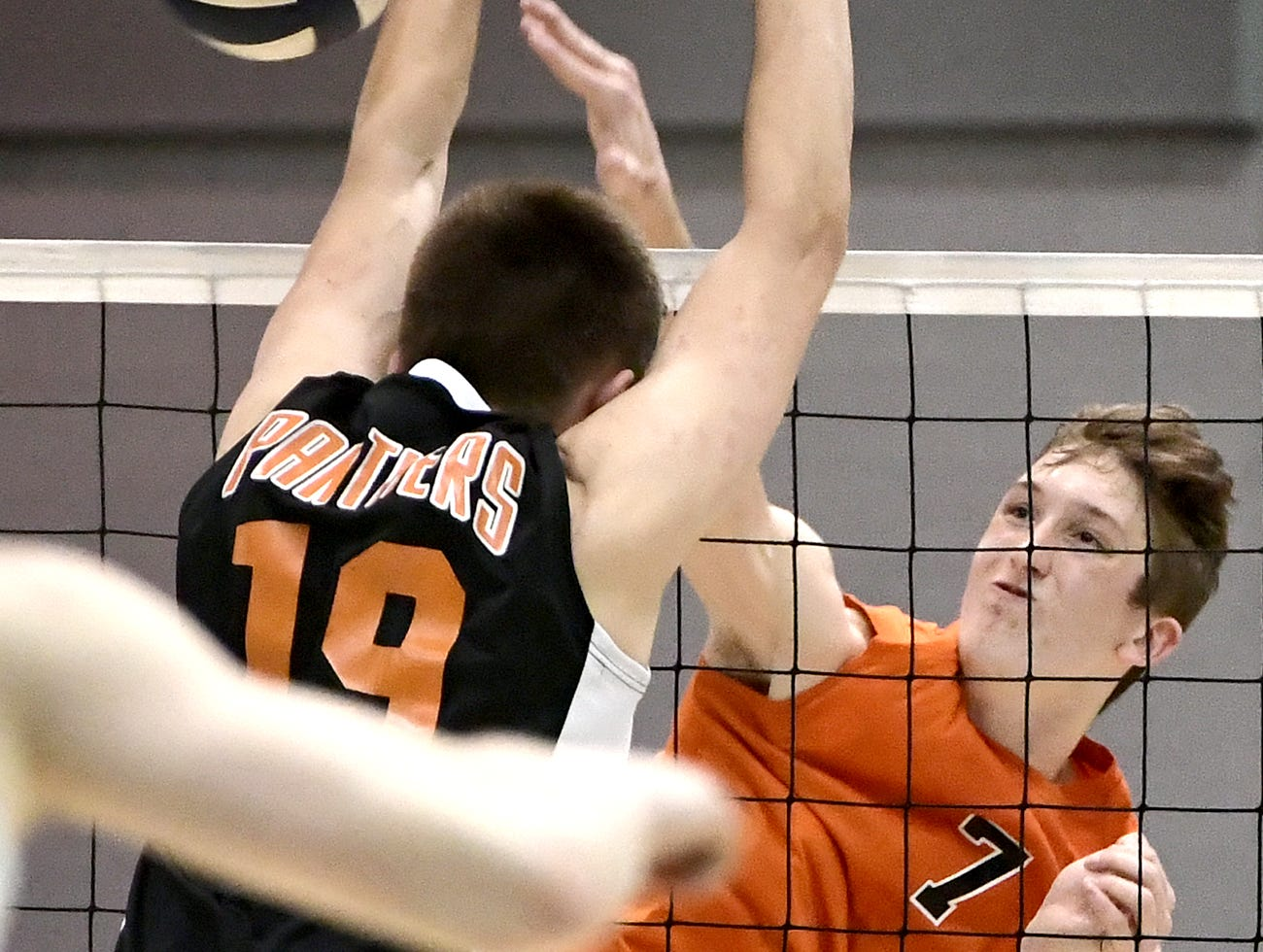 Northeastern's Alex Finch returns with Central York's Cheston Jacobs defending in the York-Adams boys' volleyball championship match at Dallastown Tuesday, May 14, 2019. Northeastern won in five games. Bill Kalina photo