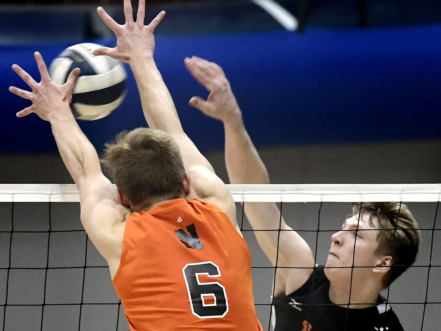 Central York's Braden Richard is challenged by Northeastern's Austin Richards in the York-Adams boys' volleyball championship match at Dallastown Tuesday, May 14, 2019. Bill Kalina photo