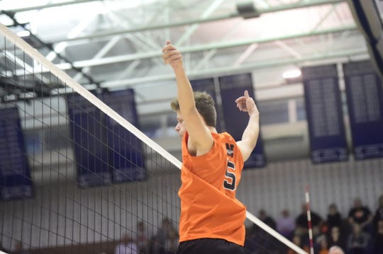 Northeastern's Nate Wilson watches a hit smack the floor for a kill during the YAIAA championship match Tuesday, May 14, 2019.