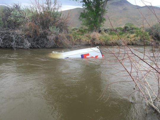 A FedEx van floats down the Walker River south of Yerington.