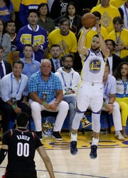 Golden State Warriors guard Stephen Curry (30) shoots a 3-point basket as Portland Trail Blazers center Enes Kanter (00) watches during the second half of Game 1 of the NBA basketball playoffs Western Conference finals in Oakland, Calif., Tuesday, May 14, 2019.
