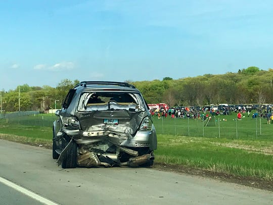 Crews responded to a two-vehicle injury car crash along Interstate 229 at Spencer Park around 5:47 p.m. Tuesday. A 22-year-old rear-ended a vehicle, which caused him to drive into the ditch and through a fence.