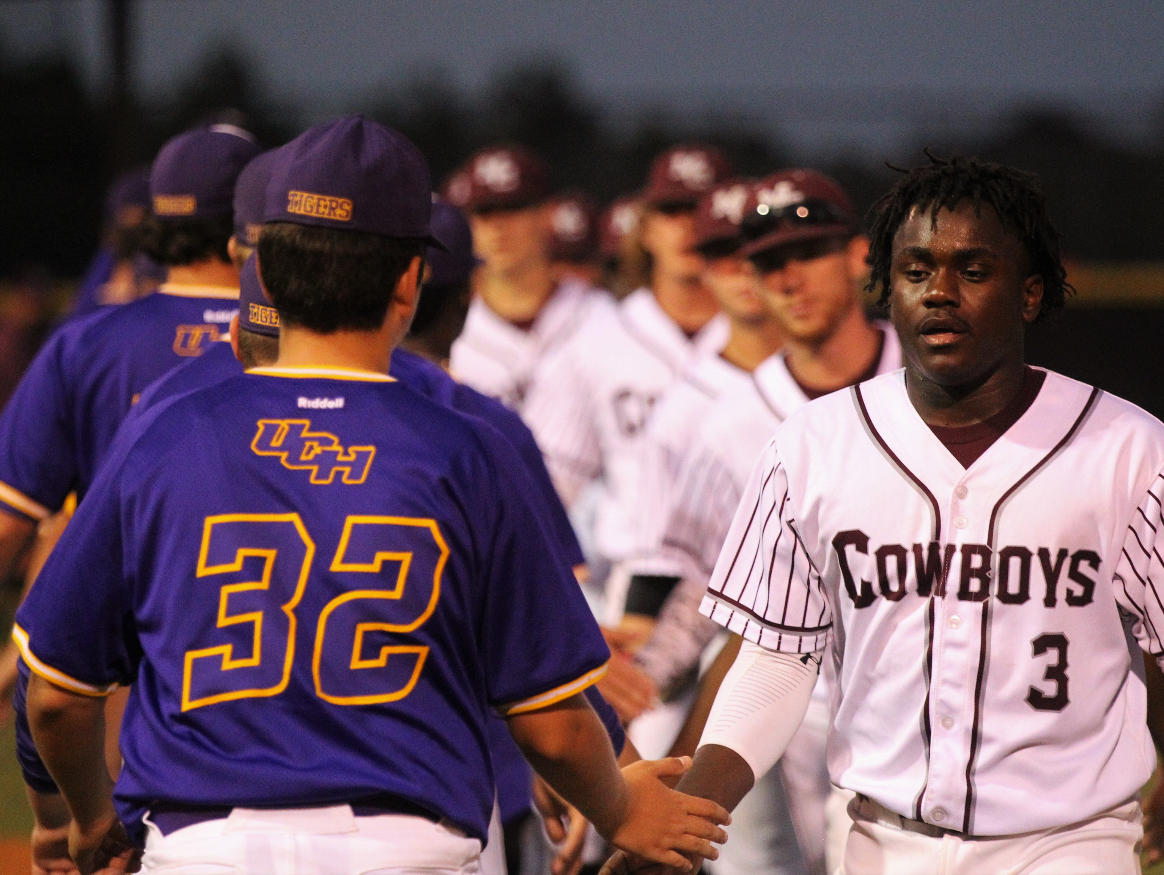Madison County senior Daquarius Thompkins leads a postgame handshake as the Cowboys beat Union County 1-0 during a Region 2-1A semifinal on May 14, 2019. The Cowboys played for former player Trey Mitchell, who died in a drowning accident last week.