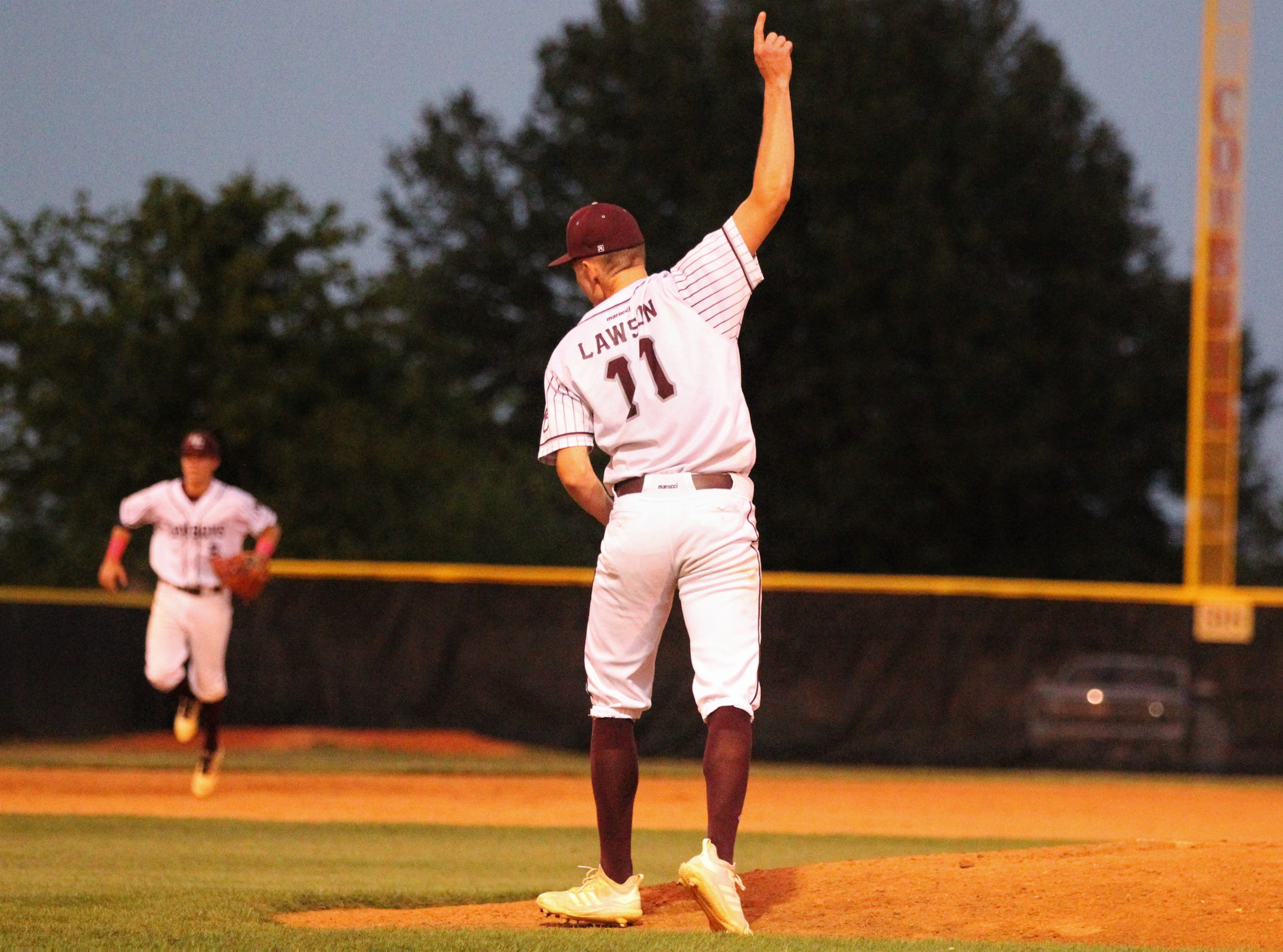 Madison County relief pitcher Dilan Lawson celebrates a game-ending strikeout as the Cowboys beat Union County 1-0 during a Region 2-1A semifinal on May 14, 2019.