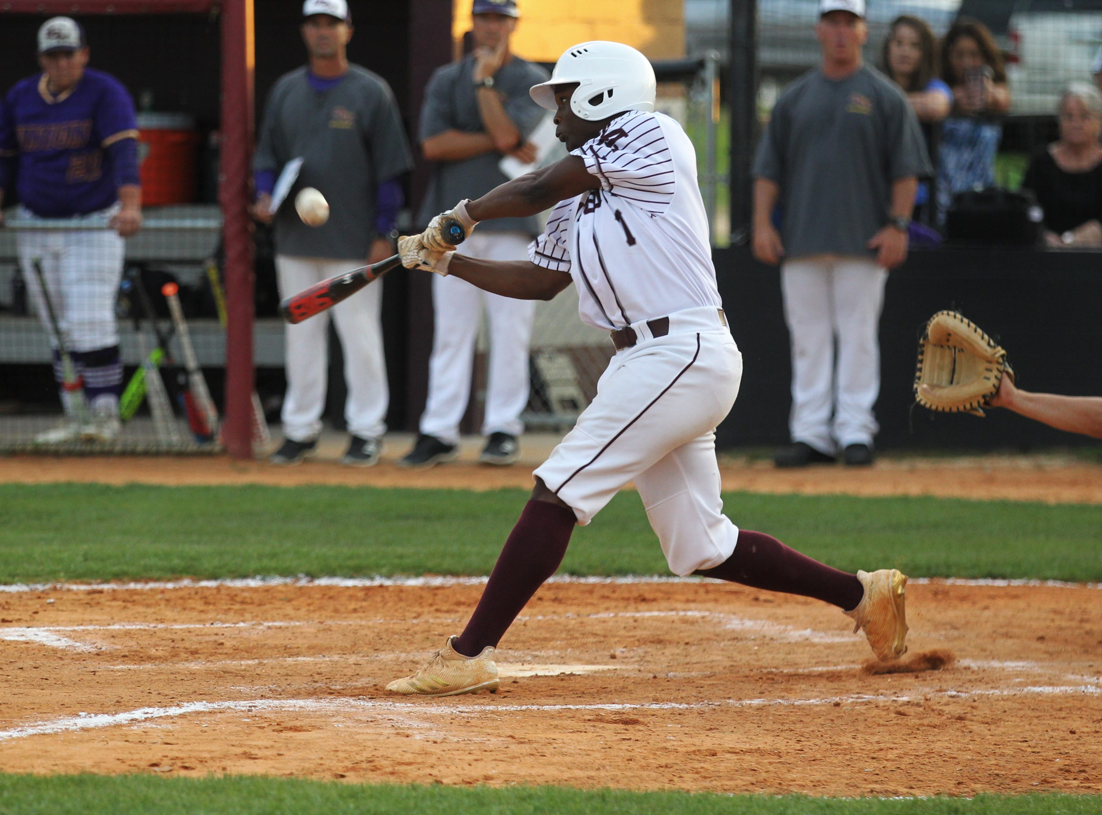 Madison County junior Vinsonta Allen bats as the Cowboys beat Union County 1-0 during a Region 2-1A semifinal on May 14, 2019.