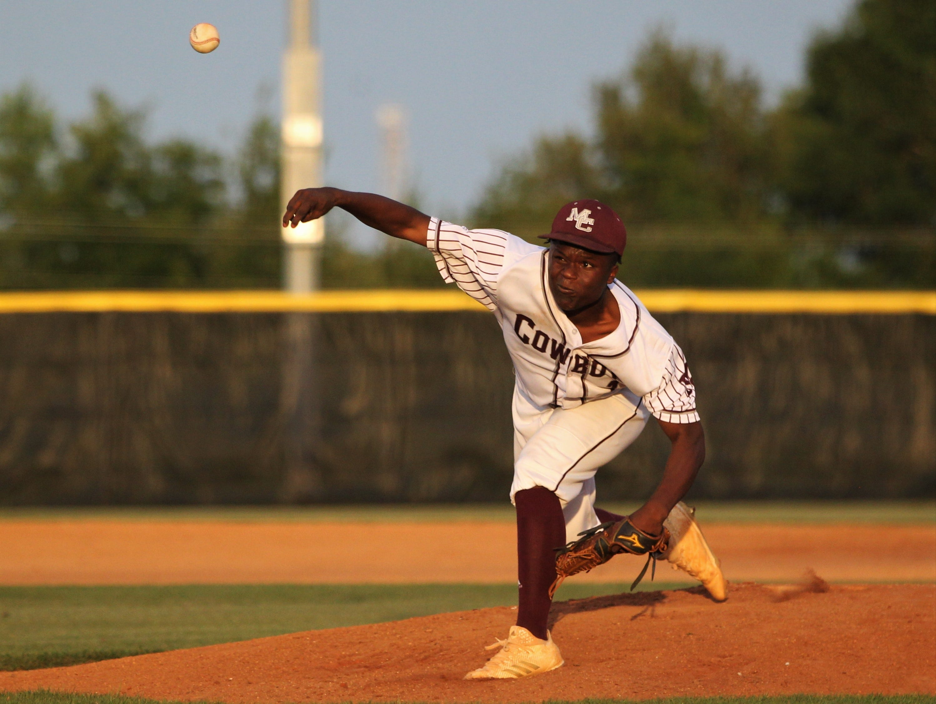 Madison County junior Vinsonta Allen pitches as the Cowboys beat Union County 1-0 during a Region 2-1A semifinal on May 14, 2019.