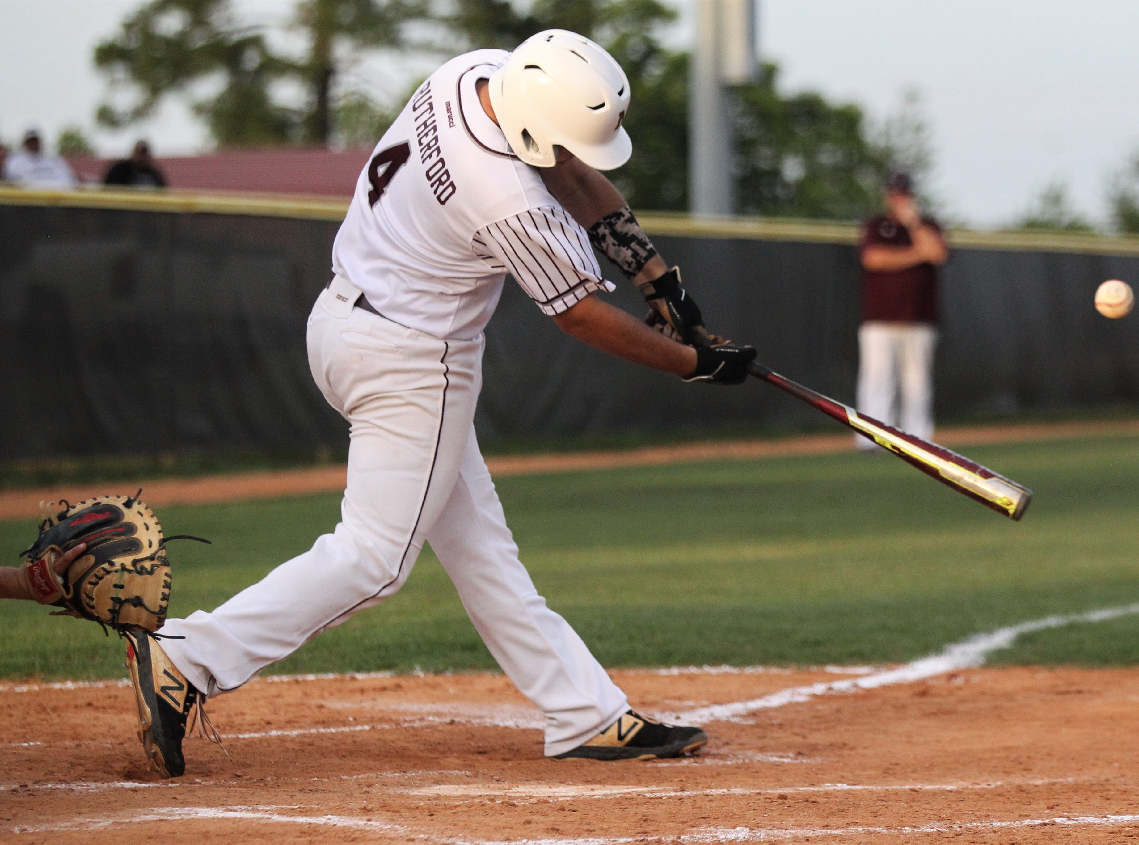 Madison County senior Dawson Rutherford bats as the Cowboys beat Union County 1-0 during a Region 2-1A semifinal on May 14, 2019.