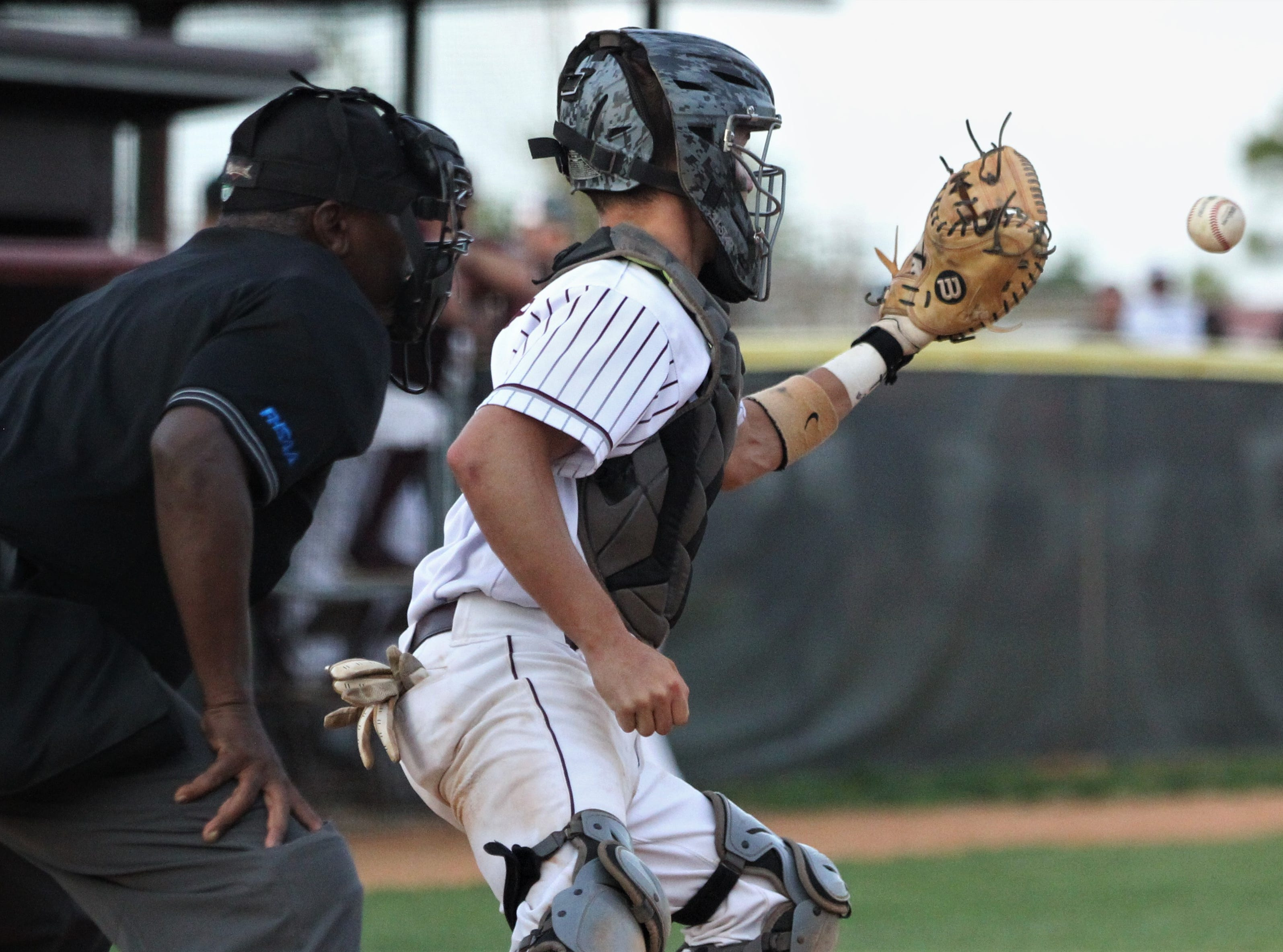 Madison County catcher Logan Lepper catches a high pitch as the Cowboys beat Union County 1-0 during a Region 2-1A semifinal on May 14, 2019.