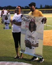 Madison County beat Union County 1-0 during a Region 2-1A semifinal on May 14, 2019. The Cowboys played for former player Trey Mitchell, who died in a drowning accident last week. His parents take a photo after the game with pictures of their son.