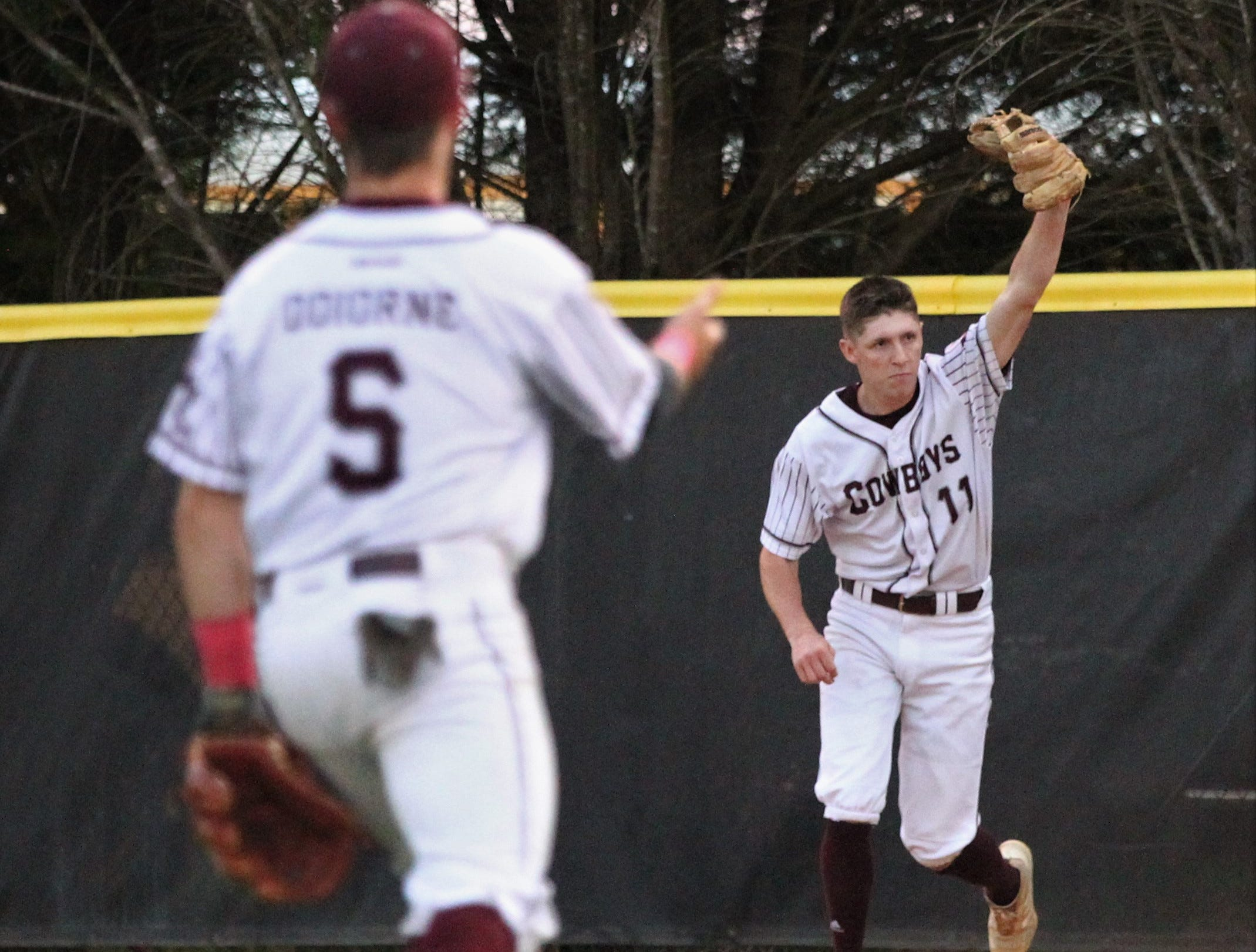 Madison County pitcher Dilan Lawson reacts after making an important running catch in the sixth inning as the Cowboys beat Union County 1-0 during a Region 2-1A semifinal on May 14, 2019.