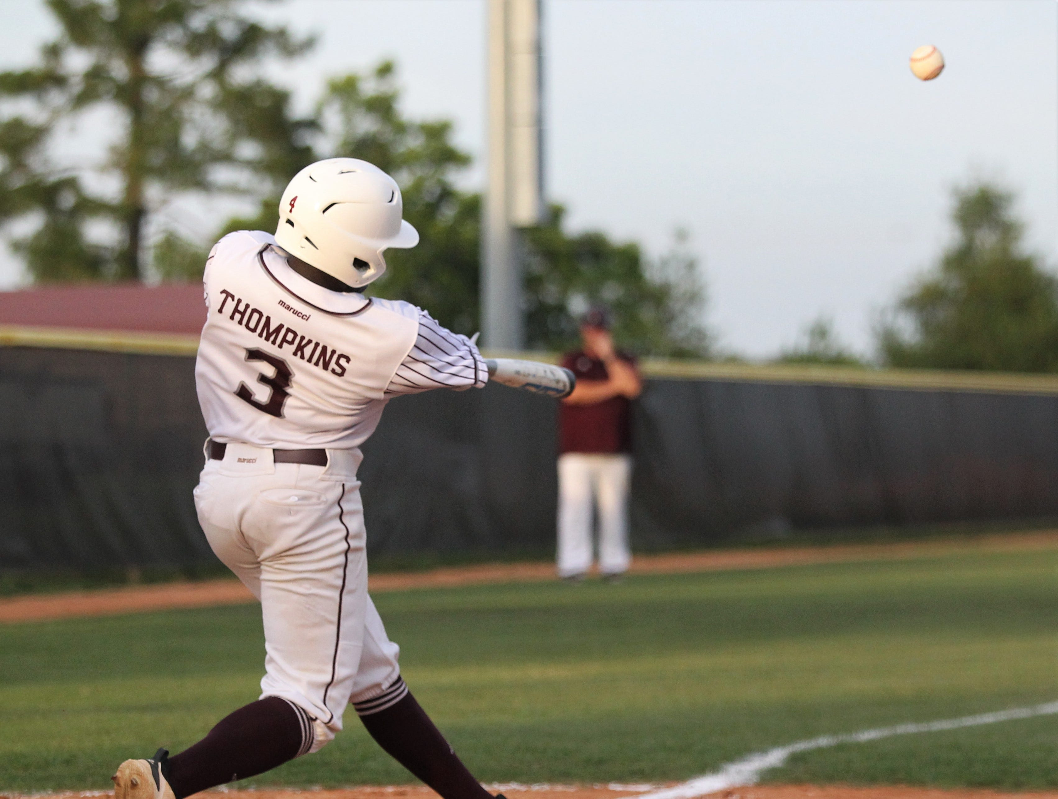 Madison County senior Daquarius Thompkins bats as the Cowboys beat Union County 1-0 during a Region 2-1A semifinal on May 14, 2019.