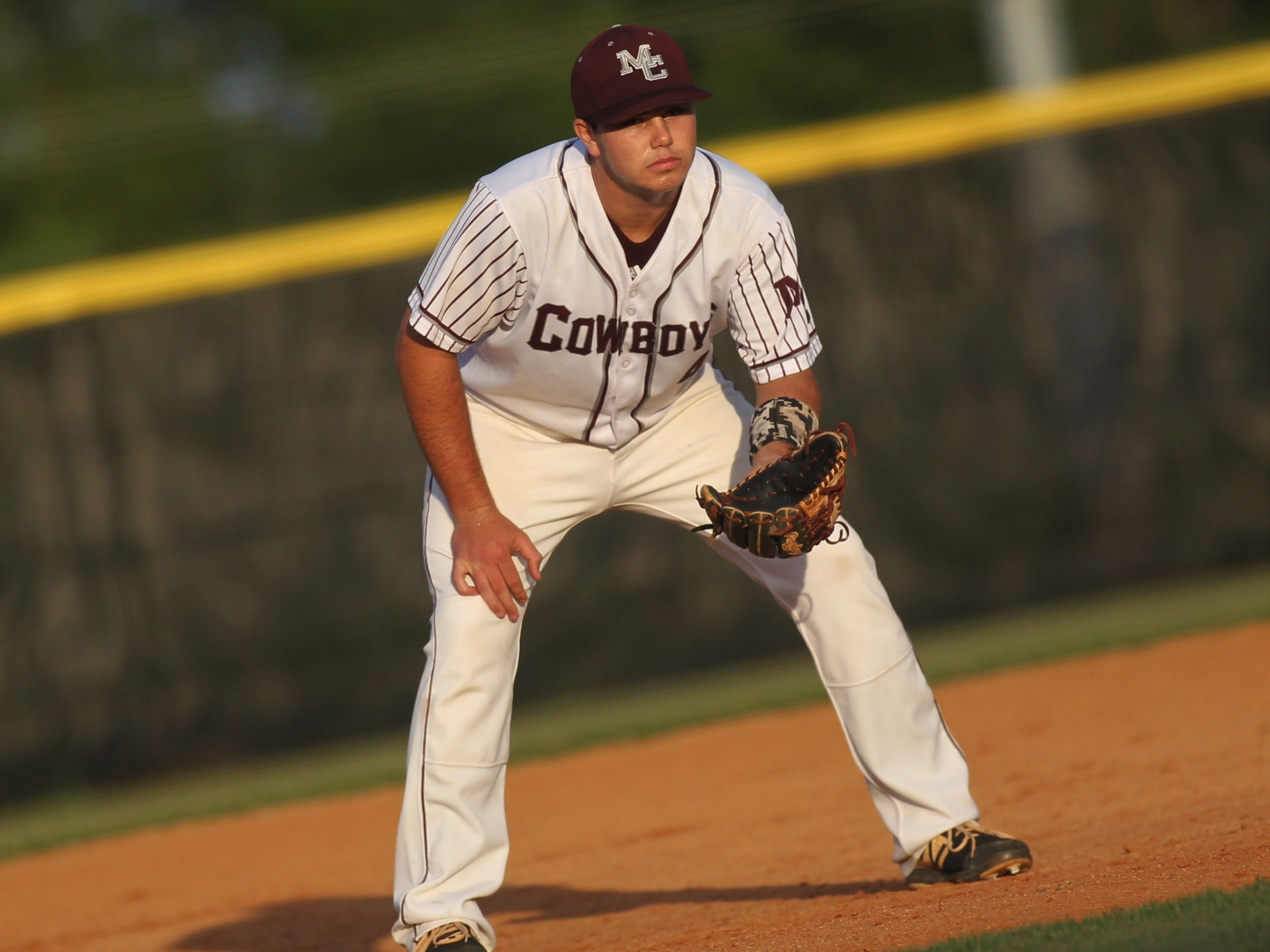Madison County third baseman Dawson Rutherford prepares defensively as the Cowboys beat Union County 1-0 during a Region 2-1A semifinal on May 14, 2019.