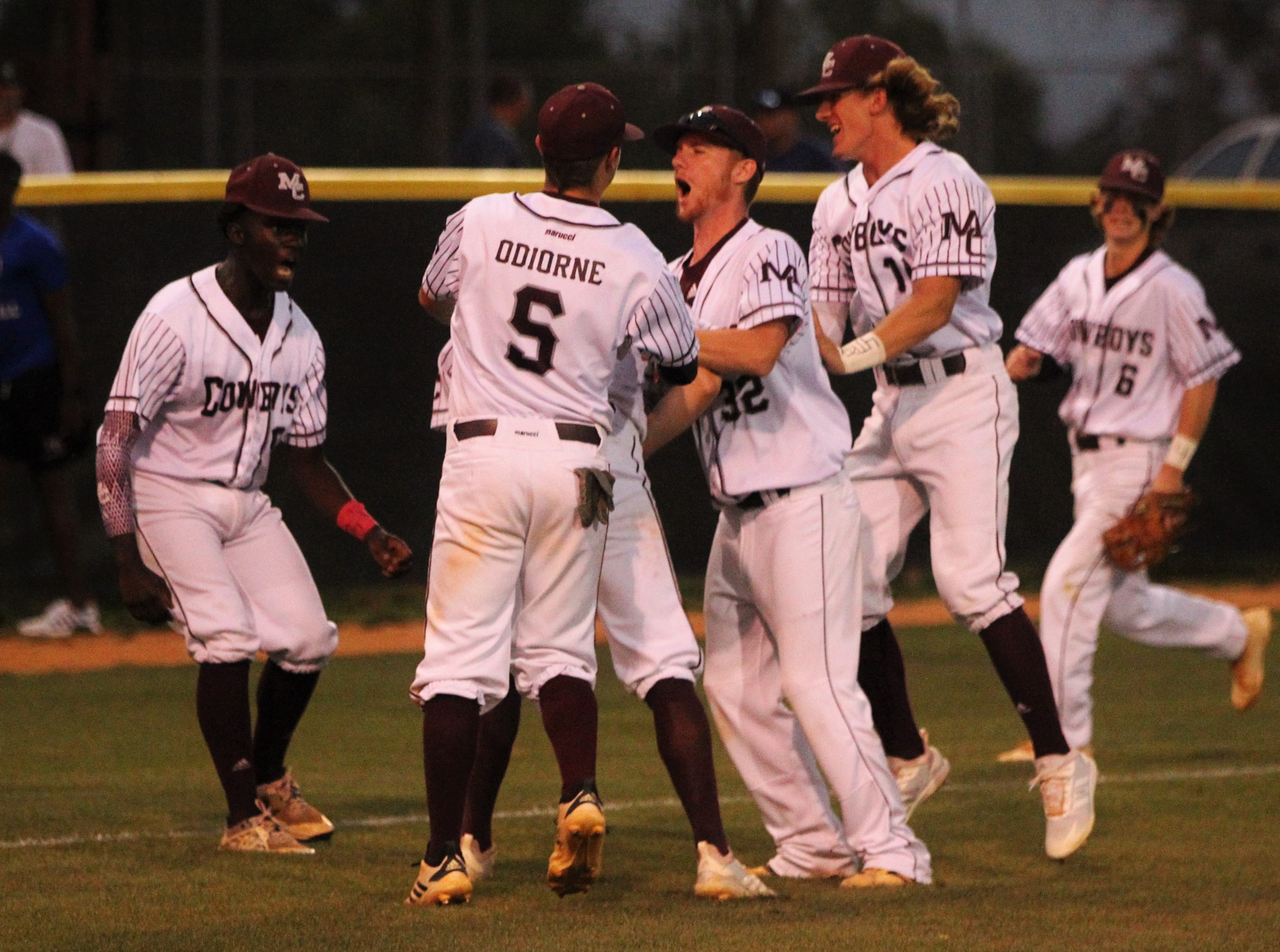 Madison County celebrates beating Union County 1-0 during a Region 2-1A semifinal on May 14, 2019. The Cowboys played for former player Trey Mitchell, who died in a drowning accident last week.