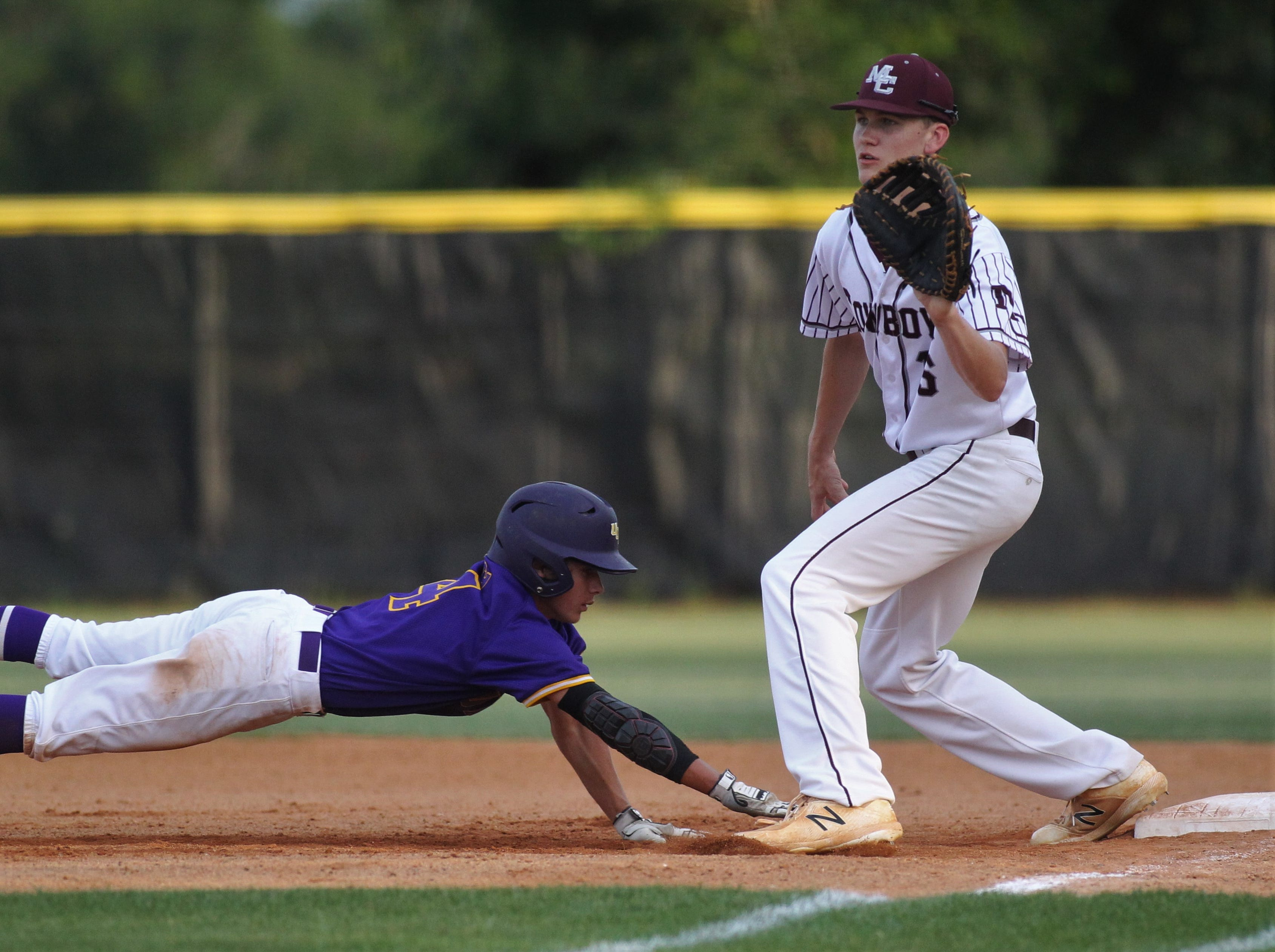 Madison County first baseman Blaydon Plain waits on a pick-off throw as the Cowboys beat Union County 1-0 during a Region 2-1A semifinal on May 14, 2019.