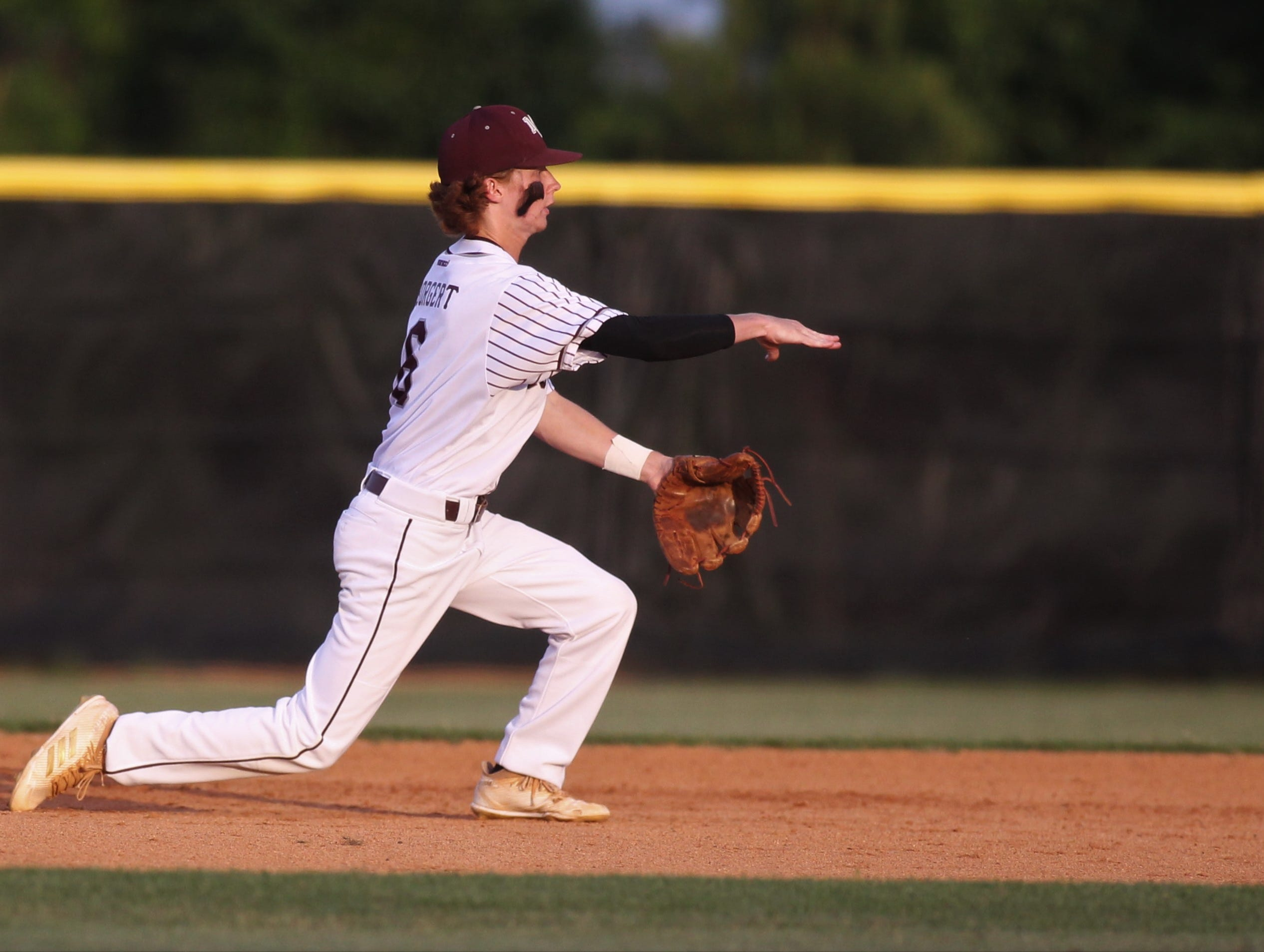 Madison County shortstop Riley Borgert throws to second as the Cowboys beat Union County 1-0 during a Region 2-1A semifinal on May 14, 2019.