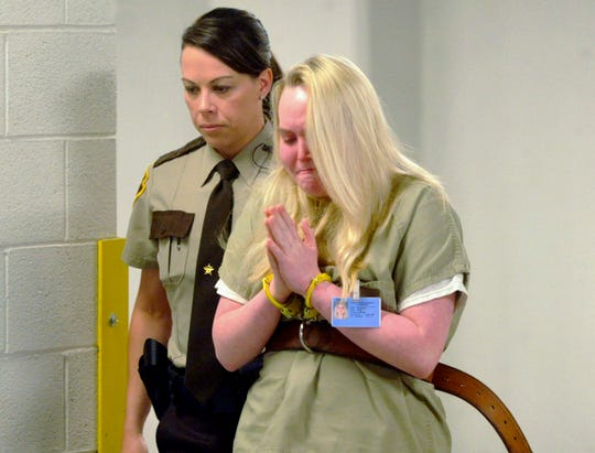 In this May 14, 2015, file photo, Jamie Silvonek is escorted to court for a preliminary hearing in Allentown, Pa. Silvonek, 18, was convicted of having her boyfriend, Caleb Barnes of El Paso, Texas, murder her mother. Barnes, a soldier, was 21 at the time.