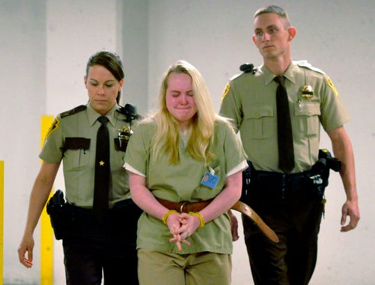 """In this May 14, 2015, file photo, Jamie Silvonek is escorted to court for a preliminary hearing in Allentown, Pa. Attorneys for Silvonek, 18, are seeking a new trial, calling the outcome of her case """"shocking."""" Silvonek was sentenced to 35 years to life after pleading guilty in the murder of her mother, 54-year-old Cheryl Silvonek. She was 14 at the time."""