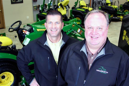 John C. Oncken (left) and Dan Gorder owners of True North Equipment at Grand Fork, ND, recently  acquired Evergreen Equipment thus moving from four to eight John Deere stores.