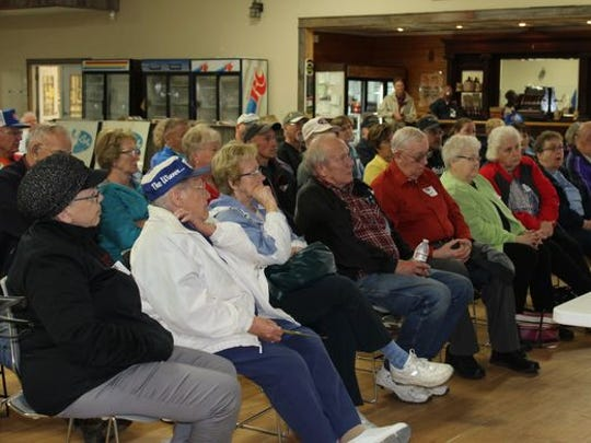 """A crowd listens to the history of the Lake to Lake Dairy Cooperative during the first of a three part series """"Our Dairy Past"""" at the Agricultural Heritage and Resource Center in Kewaunee on May 19, 2018."""