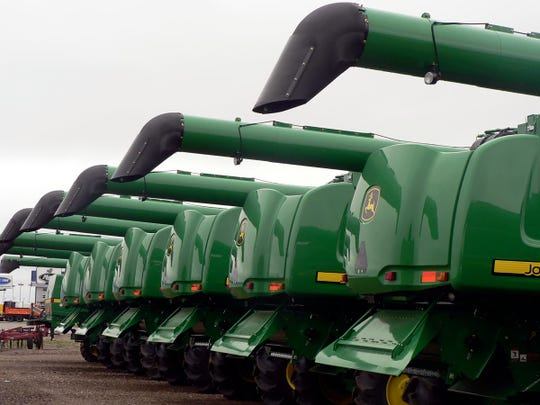 Big acreage of wheat means big combines waiting for delivery in the True North Equipment lot.