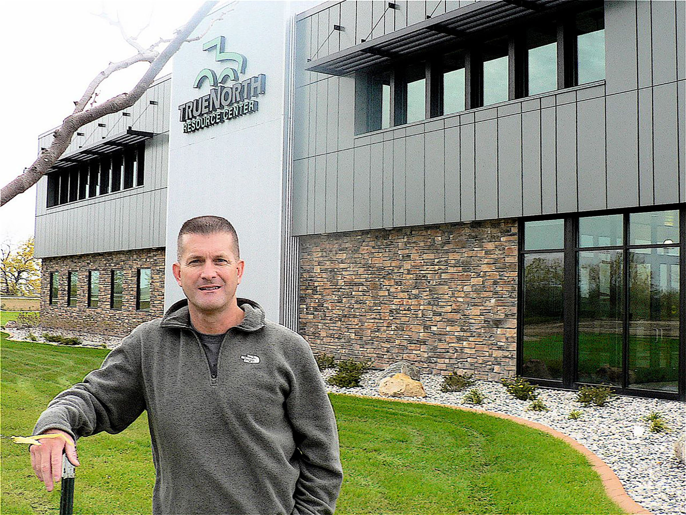 John C, Oncken poses in front of the True North Resource Center.