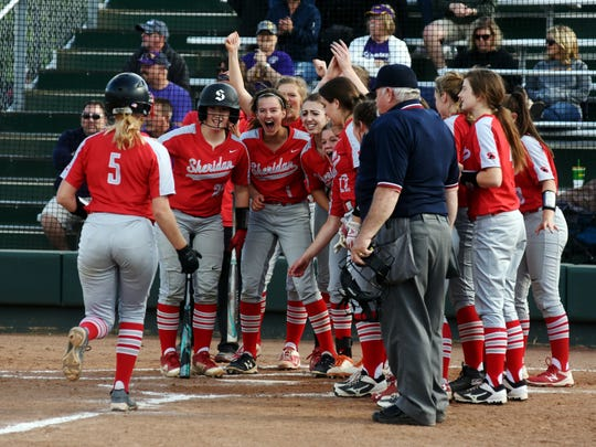 Teammates wait for Sydney Campolo after she hit a homer in in the bottom of the seventh inning to secure Sheridan's 2-1 win against Chillicothe Unioto in a Division II district semifinal on Tuesday in Athens.