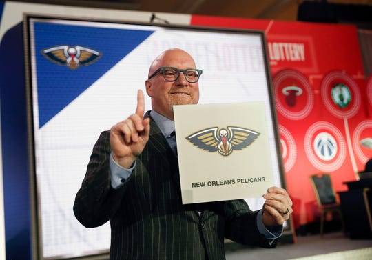 David Griffin, executive vice president of basketball operations for the New Orleans Pelicans, holds up the placard after his team won the No. 1 pick.