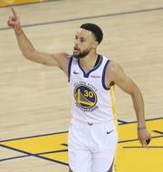 Steph Curry reacts after scoring against the Trail Blazers.
