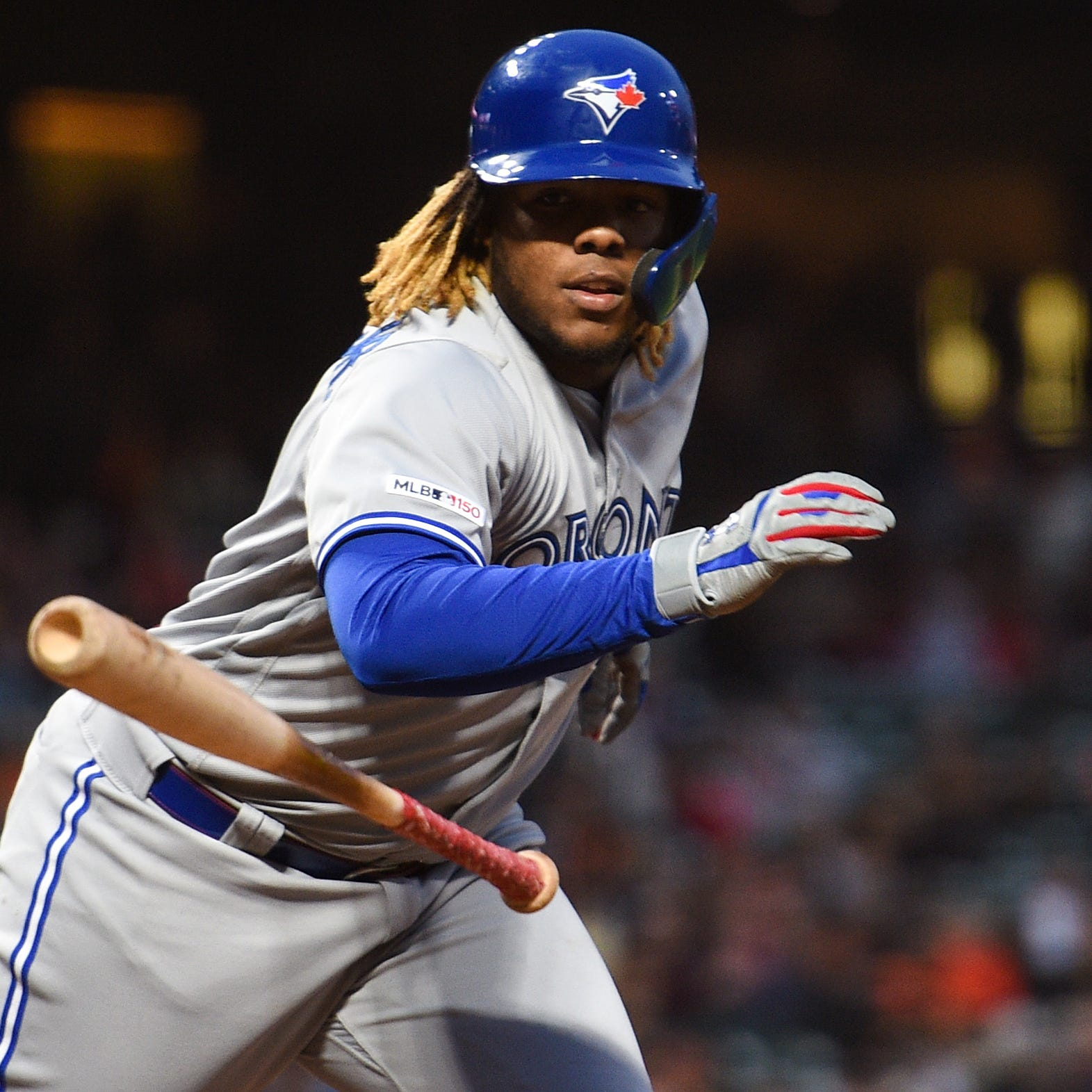 Vladimir Guerrero Jr. tosses his bat after walking against the San Francisco Giants.