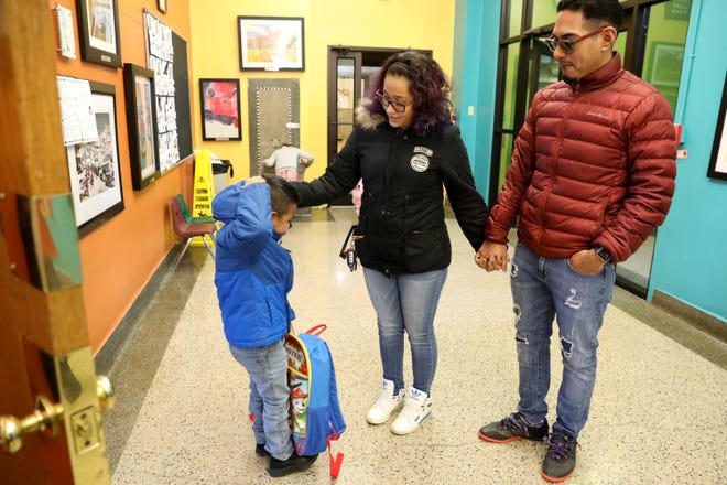 Marigeli Roman and Erick Gamboa pick up their son, Sebastian, 6, from St. Anthony School in Milwaukee on Feb. 8, 2019. Gamboa had been detained in the Kenosha County Detention Center for six months for being illegally in the country. This was the first week he was back home.