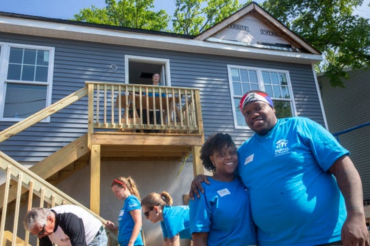 Future homeowners Kem Puryear, Roger Pharel and their 15-month-old son Jacob Pharel at the Keansburg home being built for them by Habitat for Humanity in Monmouth County.