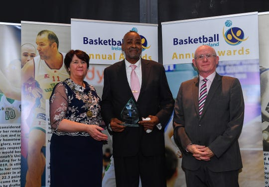 Hall of Fame Award winner Kelvin Troy is presented with his award by Theresa Walsh, President of Basketball Ireland, and Fran Ryan, Chairperson of the Board of Basketball Ireland, during the Basketball Ireland 2018/19 Annual Awards and Hall of Fame