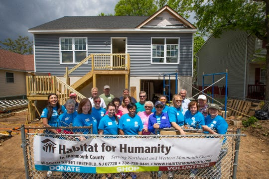 Volunteers and mentors pose for a photo of the start of day two of construction at the Keansburg site, where Habitat for Humanity in Monmouth County is building a two-bedroom home for National Guard veteran Roger Pharel, his girlfriend and their 15-month-old son.