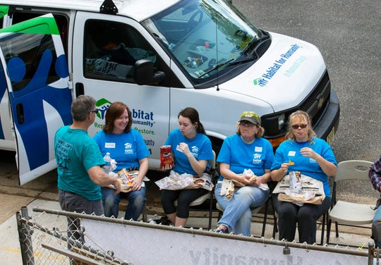 Lunch break at the Keansburg building site, where Habitat for Humanity in Monmouth County is building a home for National Guard veteran Roger Pharel, his girlfriend and their 15-month-old son. Approximately 80 women have volunteered to work on the homes as part of the Women Build Week.