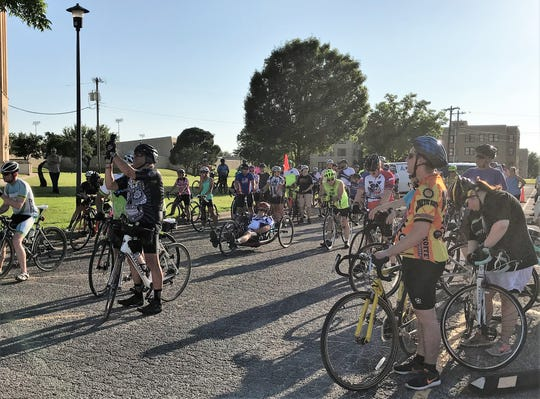 Cyclists listen to safety instructions and then a message from Taylor County Judge Downing Bolls before pedaling across south Abilene on Wednesday evening for the annual Ride of Silence to remember those who have died while on bikes. The names of local residents was read, a list that includes Court-at-Law Judge Sam Carroll, who died after a crash in 2015.