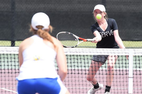 Rising Star's Caryn Lawrence hits a shot at the net during the Class 1A girls doubles final at the UIL state championships.