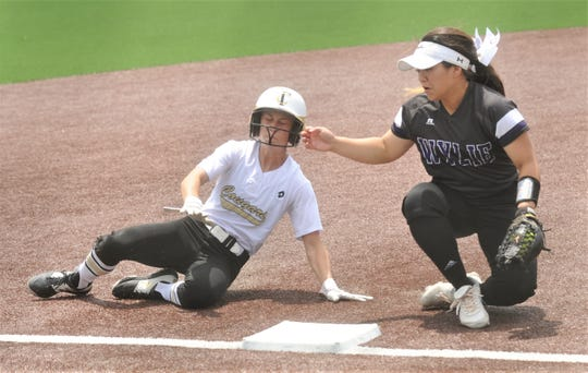 The Colony's Jacee Hamlin, left, steals third base as Wylie's Madison Owen fields the throw from home. Hamlin stole the base in the second inning and eventually scored in a two-run second for a 5-0 lead. The Colony beat Wylie 12-5 in Game 2 of the Region I-5A semifinal series Friday at Graford to sweep the series.