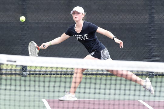 Rising Star's Abby Geye reaches for a shot on the run during the Class 1A girls doubles final at the UIL state championships in College Station on Friday.