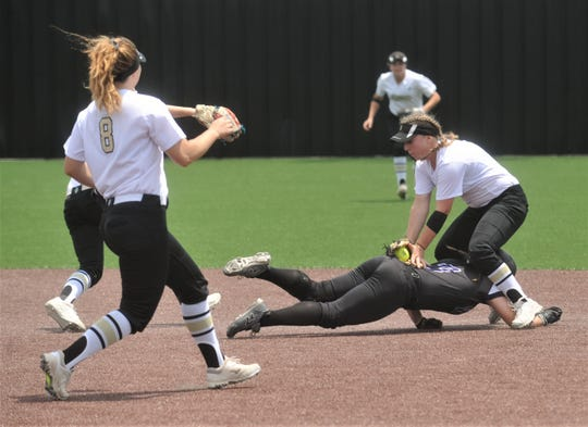 Wylie's Kaylee Philipp is tagged out by The Colony's Jodee Duncan for an inning-ending double play in the third inning. Philipp was caught in a rundown after making the turn at second following Bailey Buck's fly ball to left.