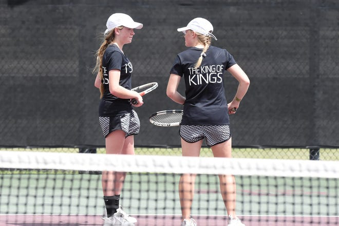 Rising Star's Caryn Lawrence, left, and Abby Geye talk between points during the Class 1A girls doubles final at the UIL state championships in College Station on Friday. Geye and Lawrence won the silver medal as state runners-up.