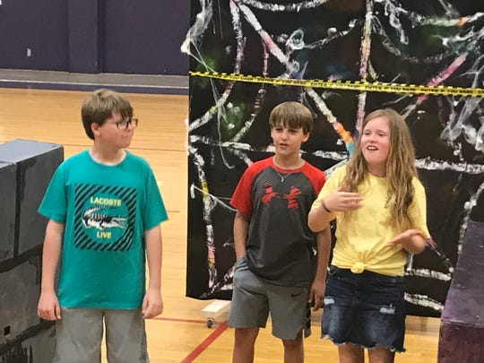 Wylie Intermediate School students Campbell McCray, left, Steven Cowling and Daisy Smith rehearse the skit for their Destination Imagination performance Thursday, May 16, 2019. The team, Chalk It Up, is one of five from Wylie going to DI's Global Finals this coming week in Kansas City, Missouri.