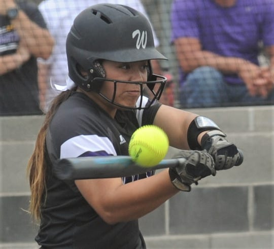 Wylie's Halle Arbilera hits an RBI ground out to short in a three-run seventh inning. It wasn't enough as The Colony won Game 2 of the Region I-5A semifinal series 12-5 to sweep the Lady Bulldogs.