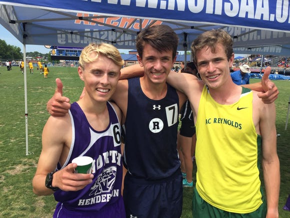 Roberson's Michael Zapherson finished third in the 1600 meter run at the NCHSAA 3A state meet. North Henderson's Hunter White (left) took fourth and Reynolds' Lucas Wiley finished 8th.