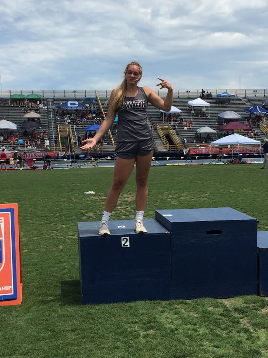 Chesney Gardner stands on the podium in Greensboro where she finished second in the state in the discus throw and fifth in the shot put on May 17.