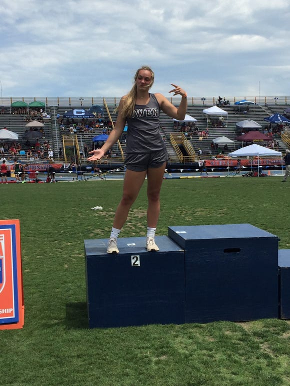 Owen's Chesney Gardner poses after finishing in second place in the discus at the NCHSAA state championships on May 17