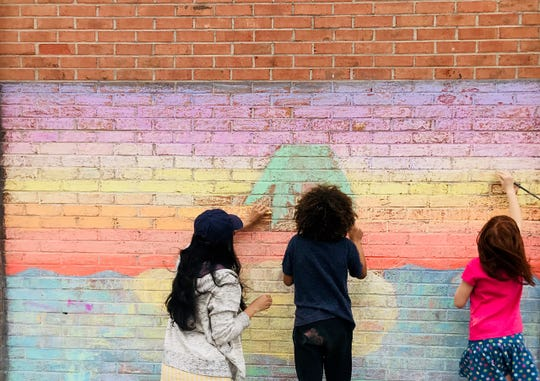 Try a different place to draw instead of a flat surface — like a wall. Use chalk or paint with water.