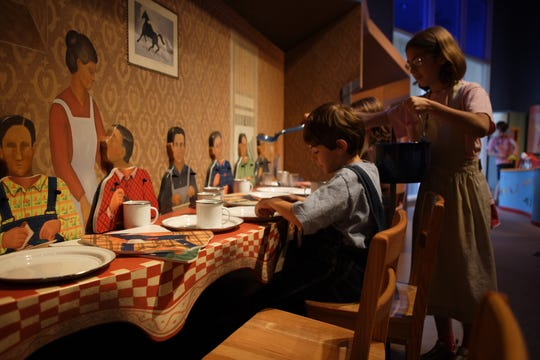 The Rockwell Museum's 'Framed: Step into Art' engages children in large-scale versions of famous works of art by inviting them to step right into the piece, such as Grant Wood's 'Dinner for Threshers.'