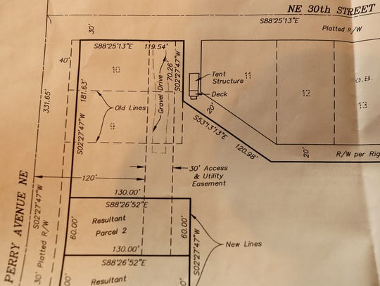 A survey that Lee Golden commissioned shows the tent structure on the county right of way with Golden's properties to the left of the encampment.