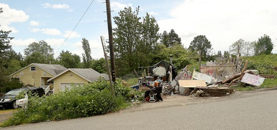 Kitsap County is suing a landowner on Perry Avenue near E. 30th Street in Bremerton in an attempt to clear up a squatter's elaborate camp. The landowner contends he doesn't own the property where the camp sits.