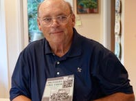 "David Rozzell holds a copy of ""Brothers Like These,"" a collection of writing from a Vietnam veterans creative writing group at the Charles George VA Medical Center in Asheville."